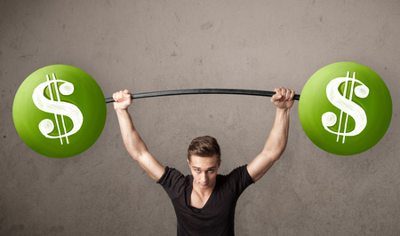 Strong muscular man lifting green dollar sign weights photo