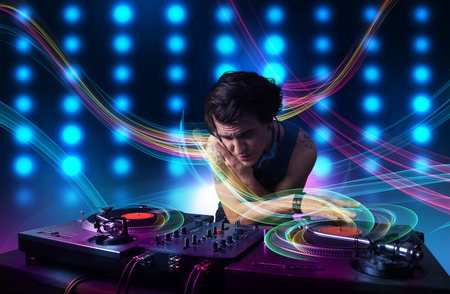 dance and electronic: Attractive young Dj mixing records with colorful lights Stock Photo