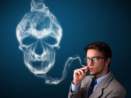 Handsome young man smoking dangerous cigarette with toxic skull smoke  photo
