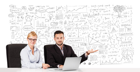 Young businessman and businesswoman planning and calculating with various business ideas photo