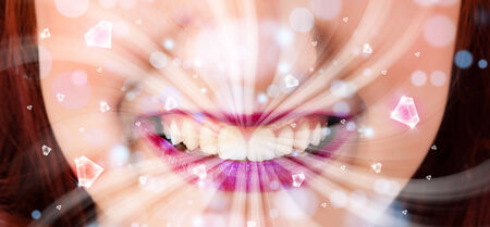 Beautiful girl mouth breathing abstract white lights and crystals close up photo