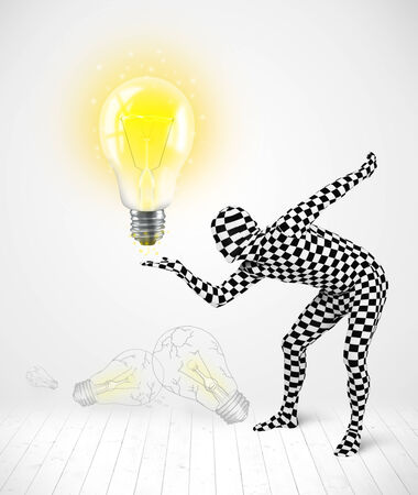 Funny man in full body suit with glowing light bulb, new idea concept photo