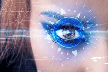 technolgy: Modern cyber girl with technolgy eye looking into blue iris