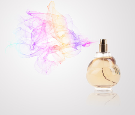 Perfume bottle spraying colorful scent photo