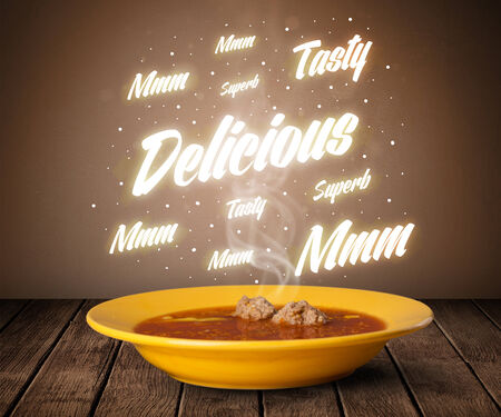 Soup with delicious and tasty glowing writings on wood deck photo