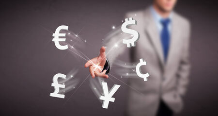 Attractive young man throwing currency icons photo