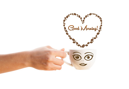 Coffee mug with coffee beans shaped heart with good morning sign, isolated on white photo