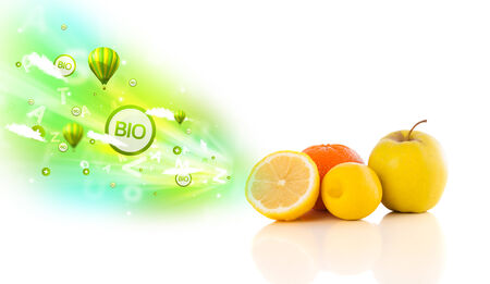 Colorful juicy fruits with green eco signs and icons on white background photo
