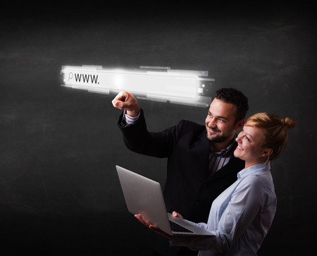 address bar: Young couple touching web browser address bar with www sign