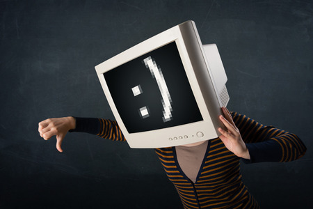 Funny girl with a monitor box on her head and a smiley face at the display photo