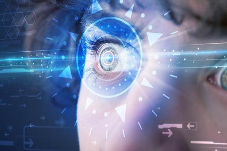 technolgy: Modern cyber man with technolgy eye looking into blue iris