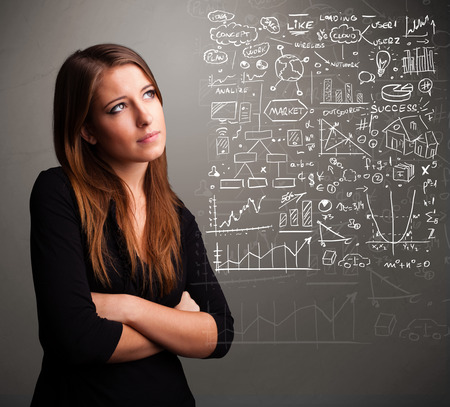 stock market: Pretty young woman looking at stock market graphs and symbols Stock Photo