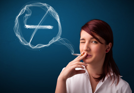 cigare: Pretty young lady smoking unheathy cigarette with no smoking sign Stock Photo