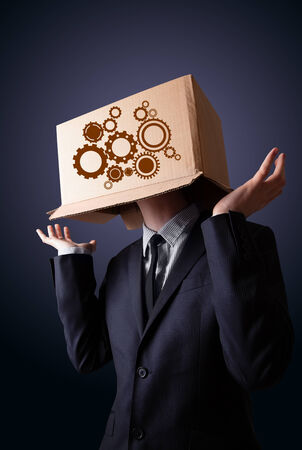 spur: Businessman standing and gesturing with a cardboard box on his head with spur wheels