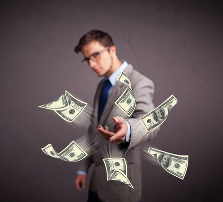 Handsome young man throwing money photo