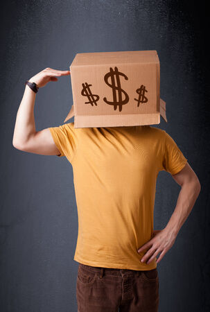 Young man standing and gesturing with a cardboard box on his head with dollar signs Stock Photo - 28937445