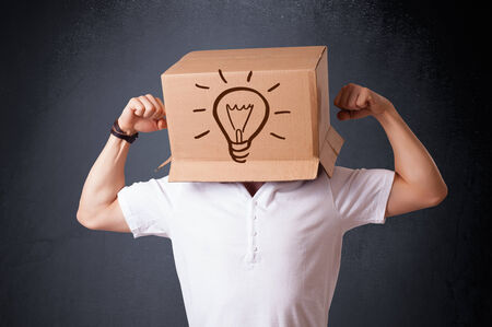 boxy: Young man standing and gesturing with a cardboard box on his head with light bulb