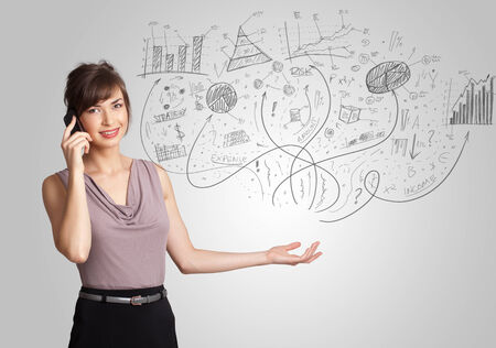 Business girl presenting hand drawn sketch graphs and charts concept photo