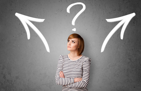 confused woman: Pretty young woman making a decision with arrows and question mark above her head