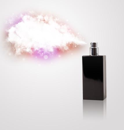 photomanipulation: womens perfume in beautiful bottle spraying colorful cloud, copyspace in cloud Stock Photo