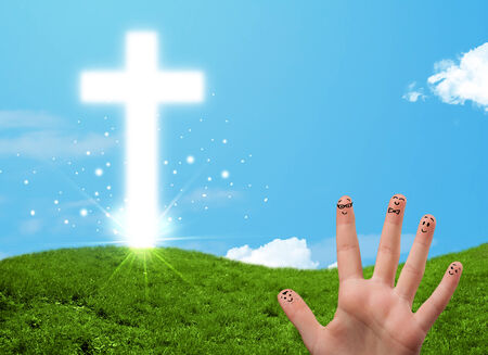 christian community: Happy finger smiley faces on hand with christian religion cross