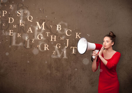 Young girl shouting into megaphone and abstract text come out photo