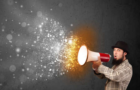 Guy shouting into megaphone and glowing energy particles explode concept photo