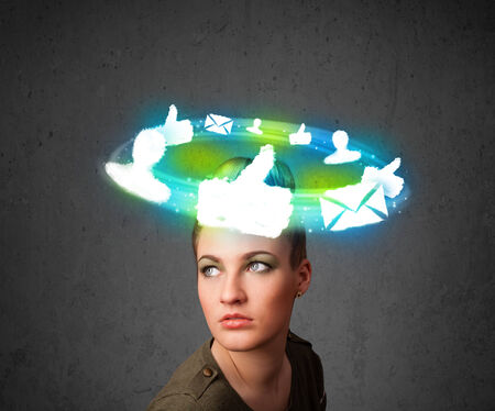 Teenager with cloud social icons around her head  photo