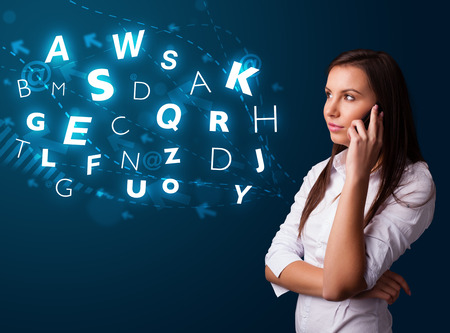 Beautiful young lady making phone call with shiny characters photo