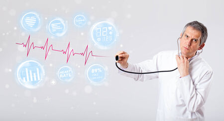 Clinical doctor examinating modern heartbeat graphics photo