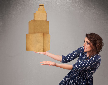 Attractive young lady holding a set of brown cardboard boxes photo