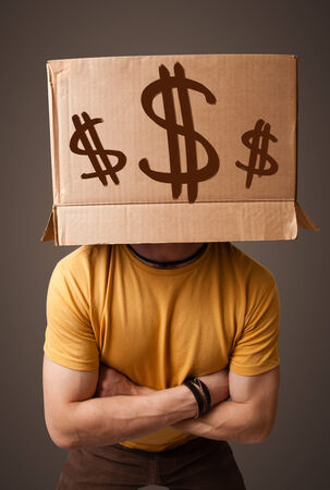 boxy: Young man standing and gesturing with a cardboard box on his head with dollar signs Stock Photo