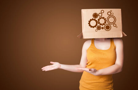 masquerader: Young woman standing and gesturing with a cardboard box on his head with spur wheels