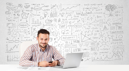 Young businessman planning and calculating with various business ideas photo