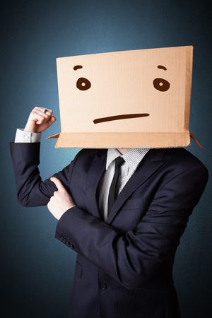 masquerader: Businessman standing and gesturing with a cardboard box on his head with straight face