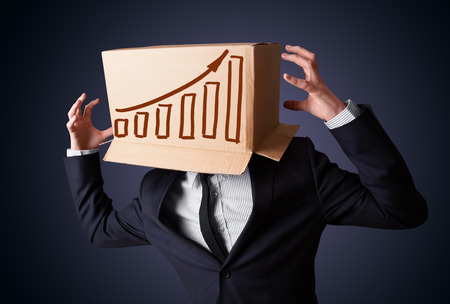 masquerader: Businessman standing and gesturing with a cardboard box on his head with diagram