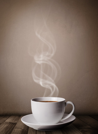 steamy: Coffee cup with abstract white steam, close up Stock Photo