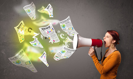 stock news: Cute girl yelling into loudspeaker and newspapers fly out