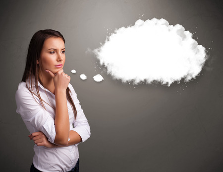 thinking cloud: Pretty young lady thinking about cloud speech or thought bubble with copy space