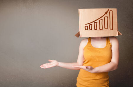 boxy: Young woman standing and gesturing with a cardboard box on his head with diagram