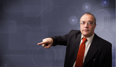 Elegant businessman standing and touching copy space photo