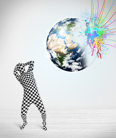 Funny man in body suit looking at colorful splatter 3d earth, Elements of this image furnished by NASA photo
