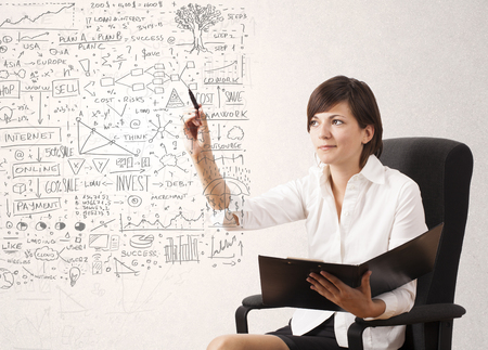 Young woman sketching and calculating thoughts and ideas photo