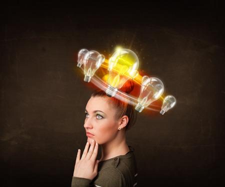 Preety woman with light bulbs circleing around her head  Stock Photo