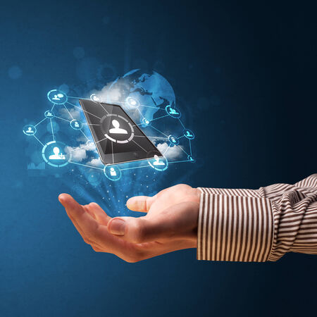 Businessman presenting cloud technology in his palm photo