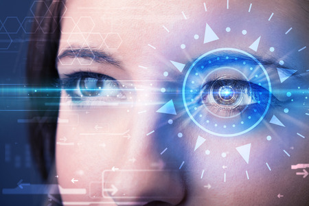 biometric: Modern cyber girl with technolgy eye looking into blue iris