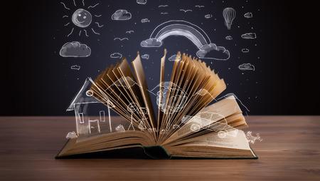 Abra el libro con dibujado a mano del paisaje en la cubierta de madera Foto de archivo - 30068699