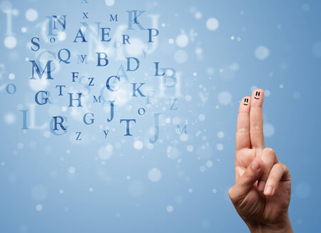 Happy cheerful smiley fingers looking at mixture of bokeh letters photo