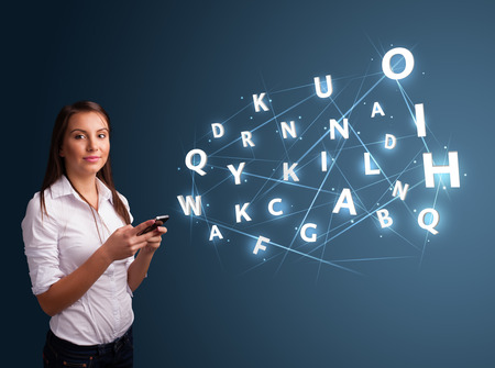 Beautiful young woman typing on smartphone with high tech 3d letters comming out photo