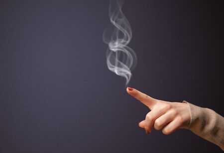sense of security: Gun shaped woman hand with smoke